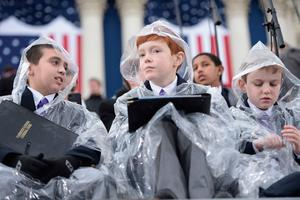 Young members of the National Cathedral Choir wait below the Capitol dome in Washington, DC, on January 20, 2017, before the swearing-in ceremony of US President-elect Donald Trump. / AFP PHOTO / Brendan SMIALOWSKIBRENDAN SMIALOWSKI/AFP/Getty Images