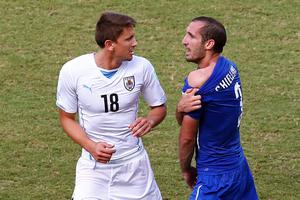 Giorgio Chiellini of Italy pulls down his shirt after a clash with Luis Suarez of Uruguay (not pictured) as Gaston Ramirez of Uruguay looks on during the 2014 FIFA World Cup Brazil Group D match between Italy and Uruguay at Estadio das Dunas on June 24, 2014 in Natal, Brazil.  (Photo by Julian Finney/Getty Images)