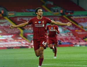 Trent Alexander Arnold celebrates netting a free-kick during Liverpool's win over Crystal Palace.