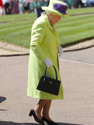 Next came the Queen in a bright green outfit (Gareth Fuller/PA)