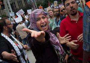 A Palestinian supporter yells at opposing Israeli supporters as hundreds protest the war between Israel and Hamas members in the Gaza Strip in Toronto on Saturday, July 26, 2014. (AP Photo/The Canadian Press, Darren Calabrese)