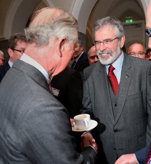 The Prince of Wales (left) shakes hands with Sinn Fein president Gerry Adams at the National University of Ireland in Galway, Ireland.