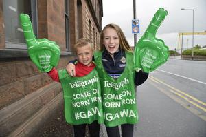 Presseye.com/Northern Ireland -16th June 2016 Photograph: Stephen Hamilton  Northern Ireland supporters pictured at the fan zone at Titanic in Belfast with Northern Ireland branded Belfast Telegraph supporters packs.    Ross and Amy Hawthorne