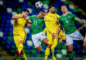 Northern Ireland's Josh Magennis and Jonny Evans and Romania's Valentin Creţu and Ionuţ Nedelcearu  in action during the Nations League game on November 18th 2020 (Photo by Kevin Scott for Belfast Telegraph)