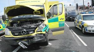 Three crew and one driver were taken to hospital after an ambulance collided with a car at the Westlink in Belfast