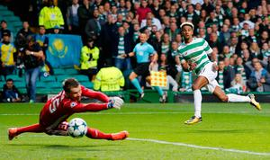 Celtic's Scott Sinclair scores his side's second goal of the game during the UEFA Champions League Play-Off, First Leg match at Celtic Park, Glasgow.