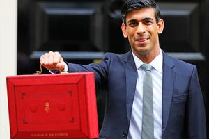 Chancellor Rishi Sunak outside 11 Downing Street, London, before heading to the House of Commons to deliver his Budget. Photo credit: Aaron Chown/PA Wire