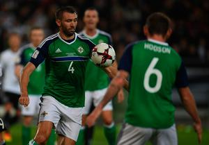 Northern Ireland´s defender Gareth McAuley vies for the ball during the WC 2018 football qualification match between Germany and Northern Ireland in Hanover, Germany on October 11, 2016. AFP/Getty Images