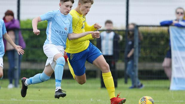 PressEye-Northern Ireland- 1st August 2019-Picture by Brian Little/PressEye Dungannon United Youth Oliwier Wasowski  and Ballymena United Kai McCormick  in  STATSports SuperCupNI  Semi Final , at Anderson Park, Coleraine . Picture by Brian Little/PressEye