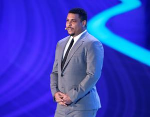 Former Brazilian soccer great Ronaldo stands on the stage during the draw ceremony for the 2014 soccer World Cup in Costa do Sauipe near Salvador, Brazil, Friday, Dec. 6, 2013. (AP Photo/Andre Penner)