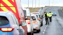 All change: PSNI officers carry out a vehicle checkpoint near Portstewart, Co Londonderry, yesterday