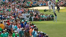 Rory McIlroy in front of a packed gallery on the third tee at Augusta
