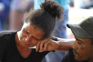 A woman cries as she waits outside the coroner's office in Altamira (Raimundo Pacco/AP)