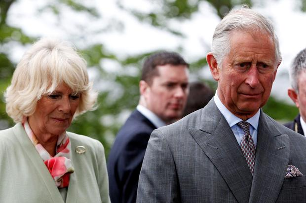 The Prince of Wales and the Duchess of Cornwall after a service of peace and reconciliation at St. Columba's Church in Drumcliffe on the second day of a four day visit to Ireland. PRESS ASSOCIATION Photo. Picture date: Wednesday May 20, 2015. See PA story ROYAL Ireland. Photo credit should read: Brian Lawless/PA Wire