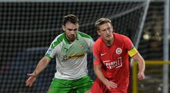 Cliftonville's Jamie Harney and Larne's Jeff Hughes during todays game at Inver Park, Larne. Photo Colm Lenaghan/Pacemaker
