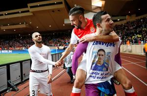 Monaco's players celebrate at the end of the UEFA Champions League football match Monaco vs Arsenal, on March 17, 2015 at Louis II stadium in Monaco. AFP PHOTO / VALERY HACHEVALERY HACHE/AFP/Getty Images