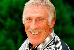 Sir Bruce Forsyth in the garden of his Surrey home celebrating being awarded an OBE in the Queen's birthday honours list. Tim Ockenden/PA Wire