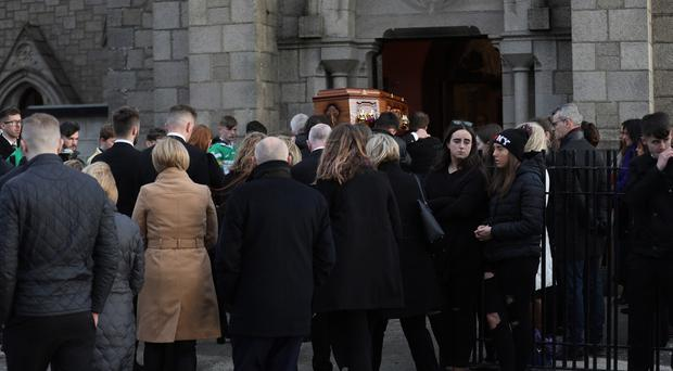 Family and Friends carry the coffin of James Grant into St Colemans Church Massforth, Kilkeel. Photo by Peter Morrison
