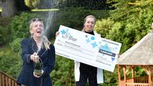 CHAMP-ANNE!!!  Derry-based inventor Anne Canavan and daughter Cressida celebrate after the mum of four became Northern Irelands latest National Lottery millionaire.  Not only did Anne scoop a life-changing ?1 MILLION in the EuroMillions Mega Friday Draw, but she will also sail away with an exclusive luxury Private Island Getaway for herself and her four children on the tropical paradise of Song Saa Island in Cambodia.   PHOTO TAKEN BY SIMON GRAHAM / HARRISON PHOTOGRAPHY.