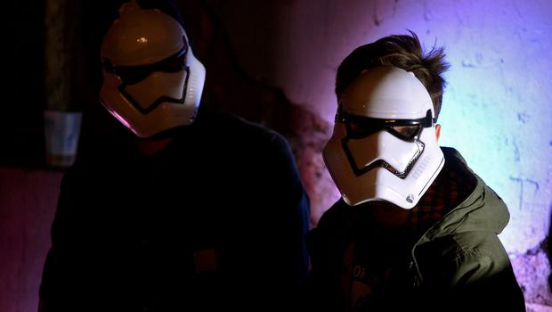 Party-goers wear Star Wars movie stormtroopers characters' outfits during a party in owntown Rome on December 15, 2015 on the eve of the premiere of the Disney movie.     The latest installment of the Star Wars series opens in cinemas in France, Italy and other European countries at the start of a global rollout of the film, whose plot has been kept under wraps by producers Disney. / AFP / FILIPPO MONTEFORTEFILIPPO MONTEFORTE/AFP/Getty Images