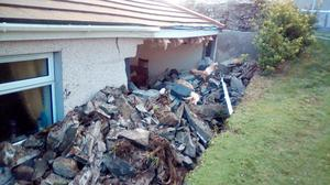 The side of the McCartans' home was caved in after the collapse of the adjoining church wall
