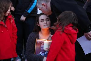 Press Eye - Belfast - Northern Ireland 19th April 2016  Seana McGibbon and joins members of the public at a vigil in the grounds of Holy Cross Church, Ardoyne, in support of the family of taxi driver  and father-of-four Michael McGibbon