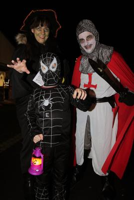 Thousands of Halloween night revellers enjoy a Twilight Night by Fairy Light at Wallace Park, Lisburn. Ethan (6) along with mum and dad Jonny and Maureen Simpson.