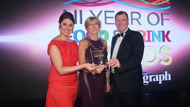 Press Eye - Belfast - Northern Ireland - 2nd February 2017 -    NI Year of Food & Drink Awards at the Culloden Hotel.  Award 9 Destination Delicious  Sarah Travers, host of the NI Year of Food & Drink Awards is pictured with Terence Brannigan, Chairman of Tourism NI and Richard McClean, Managing Director of Belfast Telegraph presenting food producers, businesses and the council of Derry~Londonderry and the North West area with the Destination Delicious Award. Judges selected the area to win the prestigious award on the night thanks to the collaborative efforts from all in the food, hospitality and tourism industries to make the region a real foodie destination. The inaugural awards celebrated the collaborative efforts of all from the food, drink and hospitality industry during the NI Year of Food & Drink 2016, with an gala awards evening at the Culloden Hotel. Pictured left to right: Sarah Travers, Ald. Hilary McClintock, Mayor Derry City and Strabane District Council and Stephen Gillespie.  Photo by Kelvin Boyes / Press Eye.