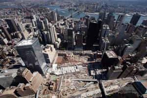 FILE - This Sept. 8, 2008 file photo shows the early stages of reconstruction starting at the World Trade Center site in New York. Thirteen years after 9/11 forever changed the New York skyline, officials say developments at the World Trade Center are on track and on budget. (AP Photo/Mark Lennihan, File)