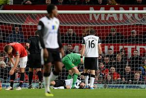Manchester United's Anders Lindegaard checks on Norwich City's Robert Snodgrass during the Capital One Cup, Fourth Round match at Old Trafford, Manchester.