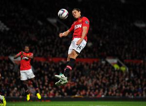Manchester United's Javier Hernandez scores his side's second goal during the Capital One Cup, Fourth Round match at Old Trafford, Manchester.