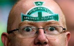 A Northern Ireland fan in the stands prior to the UEFA European Championship Qualifying match at Windsor Park, Belfast. PRESS ASSOCIATION Photo. Picture date: Thursday October 8, 2015. See PA story SOCCER N Ireland. Photo credit should read: Niall Carson/PA Wire.