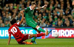 Republic of Ireland's Glenn Whelan and Georgia's Tornike Okriashvili (left) battle for the ball during the UEFA European Championship Qualifying match at the Aviva Stadium, Dublin. PRESS ASSOCIATION Photo. Picture date: Monday September 7, 2015. See PA story SOCCER Republic. Photo credit should read: Brian Lawless/PA Wire