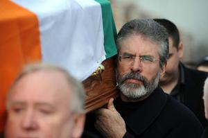 PACEMAKER BELFAST 20/2/08. Gerry Adams carries the body of former hunger striker and leading republican Brendan Hughes as his remains are taken from their family home in west Belfast this morning. Picture Charles McQuillan/Pacemaker