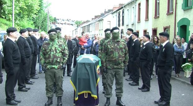 Masked men pictured at the funeral of Stephen Mellon in Londonderry. Credit: Stephen Murney.