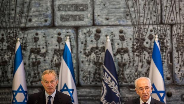 JERUSALEM, ISRAEL - JULY 15:  Isreali President Shimon Peres ( R ) seen during a meeting with International Quartet Special Envoy Tony Blair ( L )  during a press conference on July 15, 2014 in Jerusalem, Israel. . As operation 'Protective Edge' enters it's eighth day of airstrikes by the Israel Defense Forces (IDF) across the Gaza Strip, Egypt has this morning tabled a ceasefire agreement proposing a halting of fighting starting at 9am. Once violence has ceased, the proposal calls for Israel to open a border crossing into Gaza to allow the movement of goods and people. Israel has accepted the Egyptian proposal for a truce, however it is thought Hamas has rejected the deal.  (Photo by Ilia Yefimovich/Getty Images) ***BESTPIX***