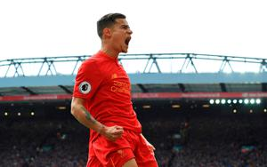 Liverpool's Philippe Coutinho celebrates scoring his side's second goal during the Premier League match at Anfield, Liverpool. PA