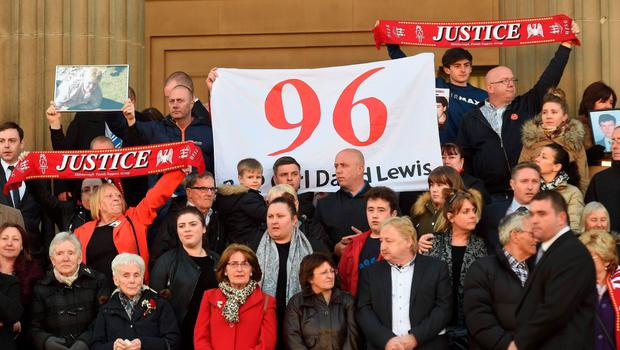 Relatives of the victims of the 1989 Hillsborough disaster gather on the steps of St George's Hall in Liverpool, north west England on April 27, 2016, in remembrance of the 96 Liverpool fans who died in the 1989 Hillsborough football stadium disaster. Thousands of sympathisers paid an emotional tribute to the Hillsborough disaster victims today after a landmark inquest found that 96 Liverpool football fans were unlawfully killed. / AFP PHOTO / PAUL ELLISPAUL ELLIS/AFP/Getty Images
