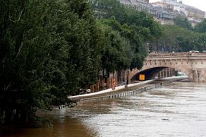 The flooded expressway by the river Seine is pictured near the Pont Neuf bridge (Rear) after its banks became flooded following heavy rainfalls on June 1, 2016 in Paris. AFP/Getty Images
