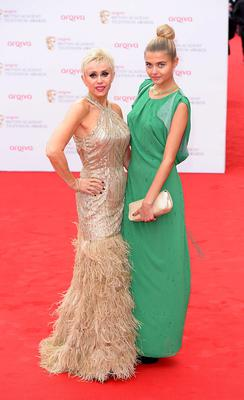 Sally (left) and Jade Farmiloe arriving for the 2013 Arqiva British Academy Television Awards at the Royal Festival Hall, London. PRESS ASSOCIATION Photo. Picture date: Sunday May 12, 2013. See PA story SHOWBIZ Bafta. Photo credit should read: Dominic Lipinski/PA Wire