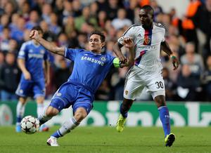 LONDON, ENGLAND - SEPTEMBER 18:  Frank Lampard of Chelsea is marshalled by Giovanni Sio of FC Basel  during the UEFA Champions League Group E Match between Chelsea and FC Basel at Stamford Bridge on September 18, 2013 in London, England.  (Photo by Ian Walton/Getty Images)