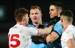 Boiling point: Tyrone's Conor Meyler and Dublin's James McCarthy clash during Saturday's game