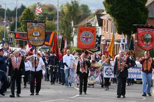 Local Orange Order lodges marched past the Ardoyne shops in north Belfast early on Saturday morning. Photographer: Matt Mackey / Press Eye