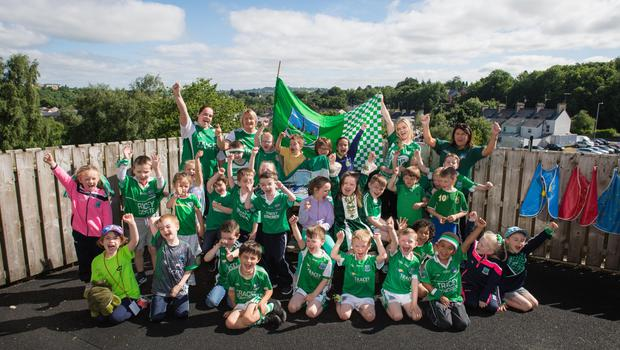 Primary 1 teachers and pupils at Holy Trinity Primary School in Enniskillen are ready for Fermanagh to take on Donegal this weekend in the Ulster Final.  All the school wore Fermanagh colours to school day on Friday in support of their home county.  Picture: Ronan McGrade