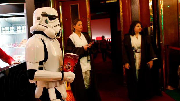 """A person wearing a """"stormtrooper"""" costume stands in the Grand Rex movie theatre during the """"Darth Vader's trial"""" event in Paris, on December 14, 2015, two days ahead of the premiere screening of the widely-anticipated Star Wars: The Force Awakens.  / AFP / THOMAS SAMSONTHOMAS SAMSON/AFP/Getty Images"""