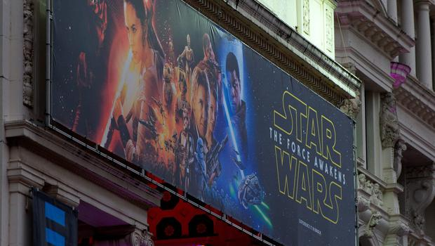 LONDON, ENGLAND - DECEMBER 15:  Star Wars promotional posters are setup in Leicester Square ahead of the European film premiere of Star Wars: The Force Awakens on December 15, 2015 in London, England. The film starring members of the original cast including  Harrison Ford, Mark Hamill, Carrie Fisher is the seventh film in the Star Wars franchise and is directed by . J. Abrams.  (Photo by Ben Pruchnie/Getty Images)