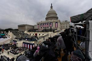 People and reporters prepare for the inauguration of US President-elect Donald Trump on January 20, 2017, in Washington, DC.  / AFP PHOTO / Mark RALSTONMARK RALSTON/AFP/Getty Images