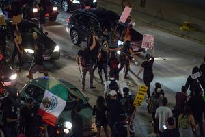 LOS ANGELES, CA - NOVEMBER 09: Protesters shut down the 101 freeway in opposition to the upset election of Republican Donald Trump over Democrat Hillary Clinton in the race for President of the United States on November 9 2016 in Los Angeles, California, United States.   (Photo by David McNew/Getty Images)