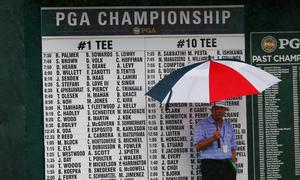 LOUISVILLE, KY - AUGUST 08:  A volunteer waits near the practice ground during the weather-delayed second round of the 96th PGA Championship at Valhalla Golf Club on August 8, 2014 in Louisville, Kentucky.  (Photo by Sam Greenwood/Getty Images)