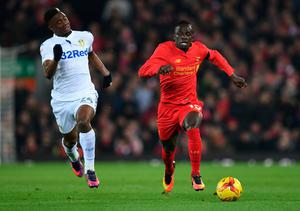 Leeds United's French midfielder Hadi Sacko (L) vies with Liverpool's Senegalese midfielder Sadio Mane during the English League Cup quarter-final football match between Liverpool and Leeds United at Anfield in Liverpool, north west England on November 29, 2016. AFP/Getty Images